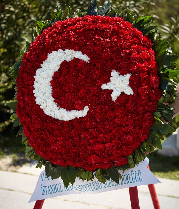 **Wreath from the Anatolian Tigers - a gang of bikers on Harley-Davidsons waving Turkish flags.**