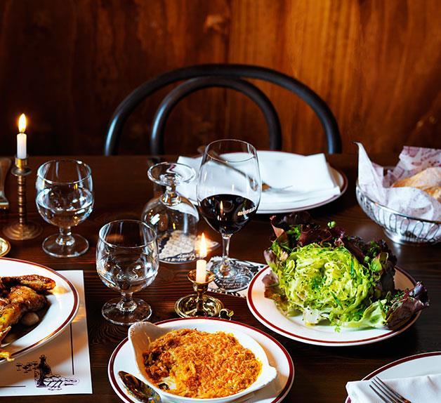 L-R Restaurant Hubert's kimchi gratin & red butter lettuce with caper and anchovy vinaigrette