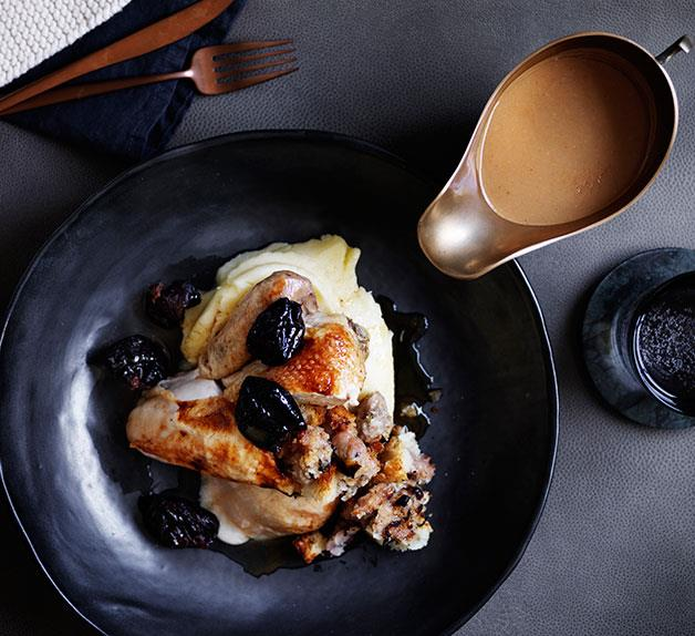 Roast chicken with sausage stuffing, prunes and pan gravy