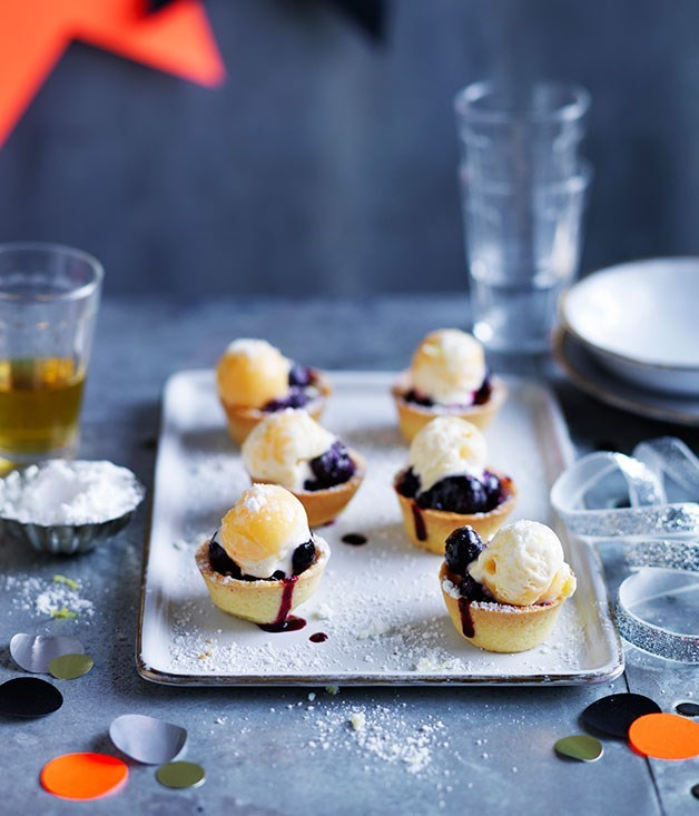 "**Mini blueberry pies with lemon curd ice-cream and sherbet** **EMMA HUTTON, EDITORIAL COORDINATOR**   ""We used to pick wild blueberries from the bushes behind our house, but they'd always disappear before reaching the kitchen. Blueberry pie is Mum's favourite, so she'll love these bite-sized tartlets, especially with a cup of tea and sweet reminiscing about the golden days."""