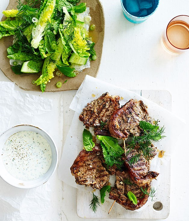 **BARBECUED GREEK LAMB CHOPS WITH MINTY SOFT FETA** An old-school chopped salad - think crisp lettuce, cucumber, spring onion, dill and mint dressed with white wine vinegar and grassy olive oil - is the perfect accompaniment to this barbecued lamb dish.