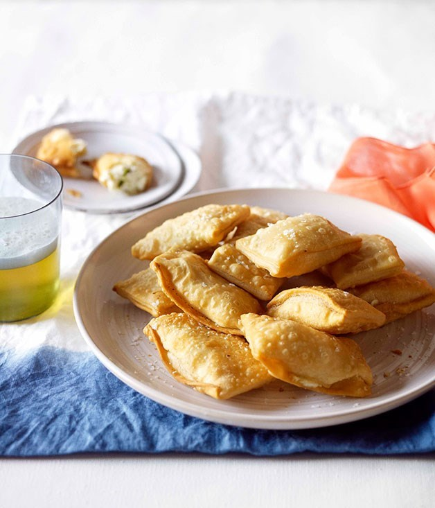 **CHEESE AND MINT KALITSOUNIA** These kalitsounia are made all over Crete and every region has its distinct way of doing them. These cheese and mint kalitsounia, which are rectangular and small, are also used as a dessert or for breakfast, drizzled with honey or dusted with sugar.