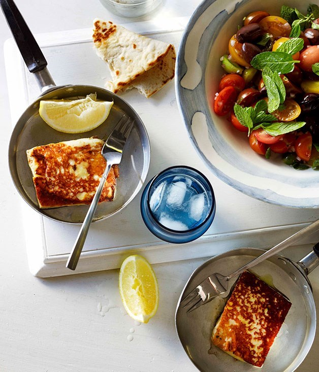 **SAGANAKI WITH TOMATO AND OREGANO SALAD** Saganaki refers to any dish cooked by a small frying pan. This salad number is best with a side ofKefalograviera, available from select delicatessens.