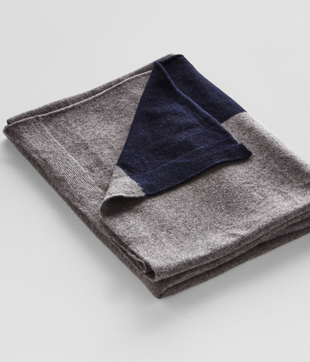 **IN BED cashmere throw rug in dark grey with navy stripe** In winter, what's better than an incredibly warm and soft throw? Made from 100 per cent Mongolian cashmere, this dark grey throw is comfortable and cosy in any situation - snuggle up with it on the couch, or wear it outside as an oversized scarf. _$380, [inbedstore.com](http://inbedstore.com/collections/cashmere/products/cashmere-throw-rug-in-dark-grey-with-navy-stripe#close)_
