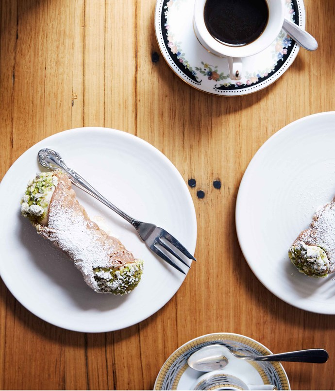 """**Cannoli at Rosa's Kitchen and Canteen** Leave the gun. Take the cannoli. Sicilian-born Rosa Mitchell's cannoli inspire Godfather-like devotion among the crowds that flock to her laneway Kitchen or the fancier legal district Canteen for her homely and utterly satisfying brand of cucina povera. And this is why: light-as-a-feather sweet, crisp pastry shells, filled with light-as-a-feather cream, dusted in crushed pistachios. It's an offer to good to refuse. Get in fast, because they run out with annoying regularity.   _[Rosa's Kitchen](/<a href="""" http:/www.rosas-kitchen.com/"""" rel=""""nofollow""""> Rosa's Kitchen</a>), 22 Punch La, Melbourne; (03) 9662 2883, and [Rosa's Canteen](/<a href="""" http:/www.rosascanteen.com.au/"""" rel=""""nofollow""""> Rosa's Canteen</a>), 1 Thompson St (cnr Little Bourke St), Melbourne; (03) 9602 5491_  ____Photography by Peter Tarasiuk.___   _"""