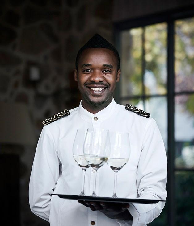 **Grande Provence White 2014** Waiter Foster Soko serves Grande Provence White 2014.