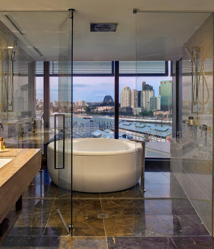 "**The Darling, Pyrmont, NSW** <br><br> Part of The Star complex in Sydney's Pyrmont, the Darling's Adored Suite bathroom is a glossy marble affair. A circular, freestanding bath looks out floor-to-ceiling glass across Darling Harbour, all the way to the Bridge.  *The Darling, 80 Pyrmont St, Pyrmont, NSW, [thedarling.com.au](https://www.thedarling.com.au/|target=""_blank""