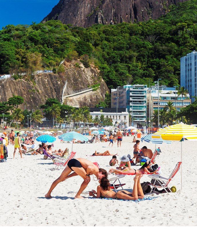 **Couple kiss on Leblon beach** A couple share a kiss on Leblon beach, Rio de Janeiro.