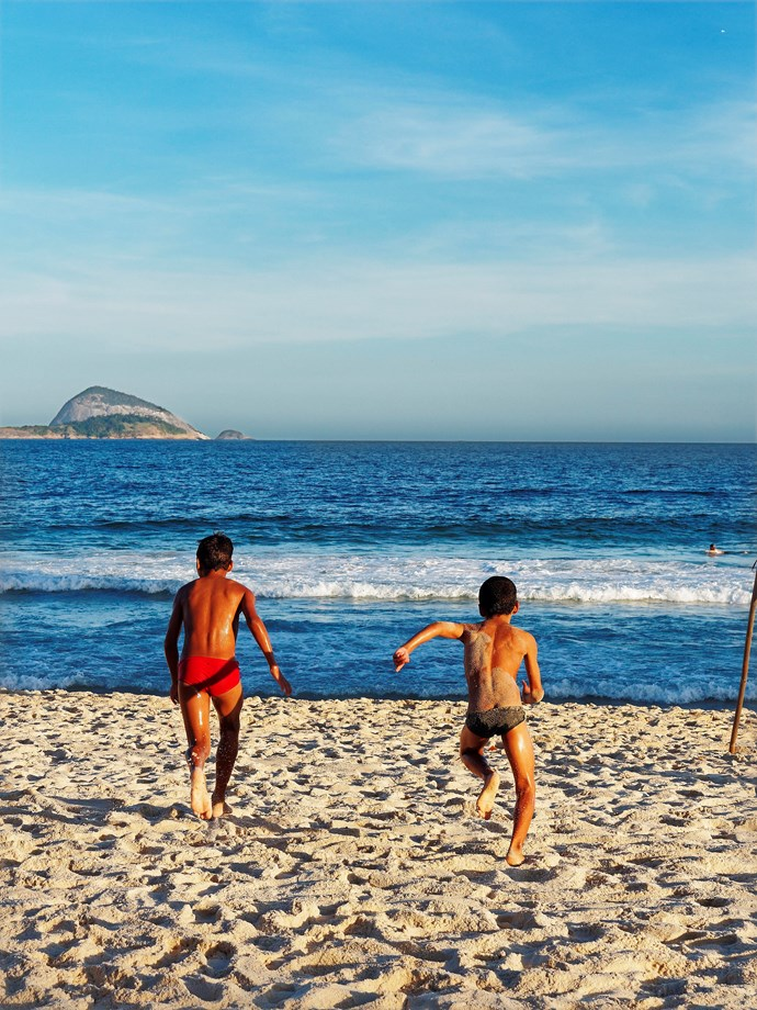 **Children on Ipanema beach** Two children rush towards the surf in the late afternoon, Ipanema beach.