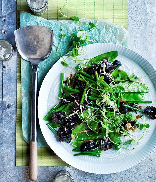**Stir-fried black fungus with ginger, garlic stems and snow peas**