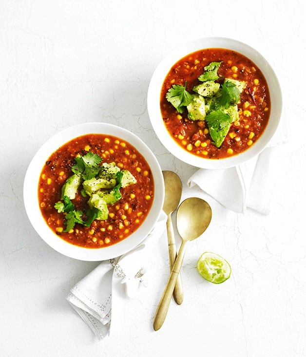 **Corn soup with avocado and lime** This hot Mexican soup is cooled down by the addition of avocado, lime and coriander, and is great in winter.