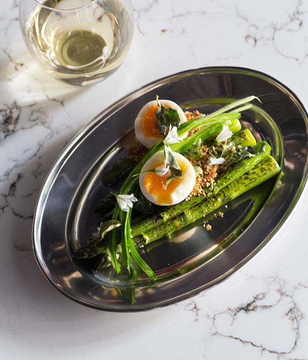 """**Asparagus, broken egg and saltbush** """"This is a great spring side for chook. The asparagus is from a good mate of ours, an old-timer by the name of John Hobson. Hobbo is about 70 and is as particular about his asparagus as I am about my chickens. For opening we're char-grilling the spears and serving them with a soft-boiled egg and a confit shallot dressing with saltbush and wild garlic."""""""