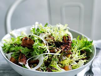 Octopus, frisée and fennel salad with lardons and lentil dressing