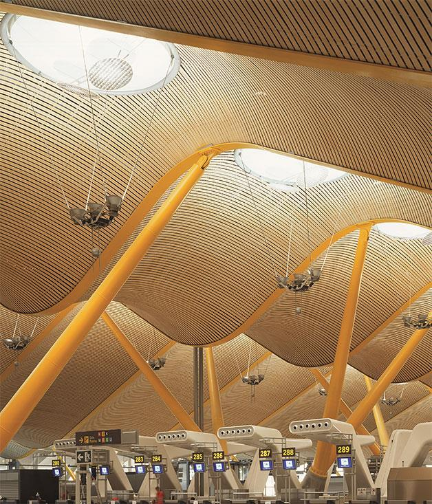 **Terminal 4, Madrid's Barajas Airport** Featuring waves of bamboo panelling, multi-coloured steel supports and a flooding of natural light, terminal 4 at Adolfo Suárez Madrid-Barajas Airport is highly regarded for its calm and bright atmosphere.  _Photo by Roland Halbe/Artur Images. _
