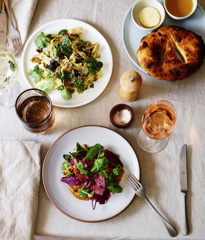 "**Baby artichoke and cipollini onion salad; grilled snow pea and red orach salad; Fred's fougasse** ""I really love the idea of starting with a salad, then maybe having a bit of pasta or a squid dish, and then moving onto a main. It's a really nice progression. The artichoke for our shaved artichoke salad is from two farms, Marty Boetz's Cook's Co-op, and Johnstone's Kitchen Gardens on the way to the Hawkesbury. We do it with flowering mâche, the roasted cipollini onions, kombu oil, and a bit of shaved Italian cow's milk cheese (it's called Ossolana al Prunent - one of my favourites).  ""Another salad is the snowpea salad; the peas also come out of the wood-oven, and then are served with purple orach leaves, basil and a sweet-savoury dressing made from pepita seeds, dried chilli and prunes."""