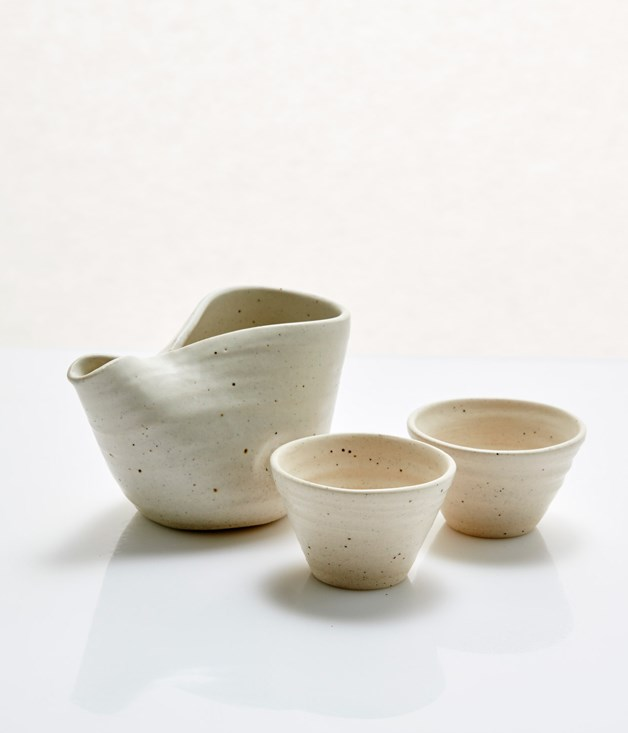 **Mukumono Ceramics White Katakuchi Pourer - $62** **[Buy it here.](http://sorrythanksiloveyou.com/mukumono-ceramics-white-katakuchi-pourer)** Sake cups sold separately **[here](http://sorrythanksiloveyou.com/mukumono-ceramics-white-sake-cup).**  Katakuchi are traditionally used for sake but this thoughtful pourer from Mukumono Ceramics could also be used for tea, sauces, and dressings. Ceramicist Ion Fukazawa hand-throws the pourers on a manual wheel, each one made from a singular form. The result is a fluid, ergonomic shape which balances a traditional Japanese aesthetic with a more robust and earthy Australian bent.