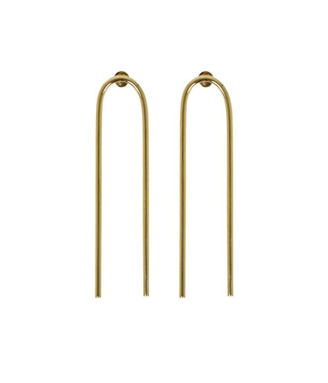 **Jennifer Fisher XL Smooth Bend Earrings** Just as fun as novelty Christmas earrings.  _$525, [from Parlour X](http://www.parlourx.com/styles/jewellery/interlocking-smooth-circle-earrings-yellow-gold.html)_