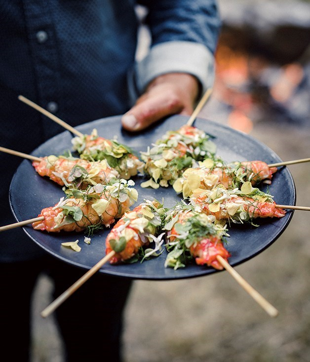 **Grilled marron on a stick with citrus butter, flowers and herbs**