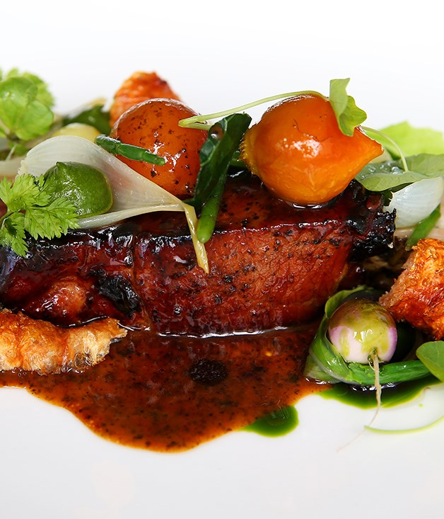 **Monty Koludrovic's charcoal glazed pork neck, fragrant baked vegetables and laver sauce**