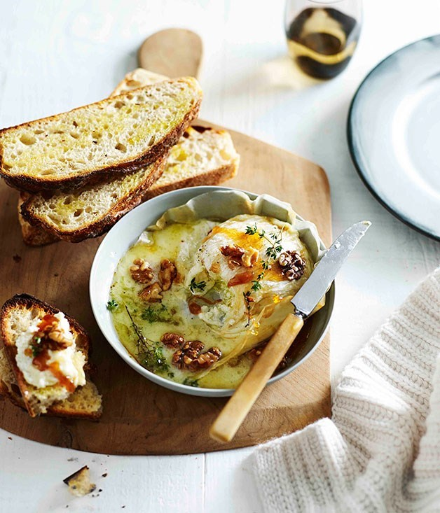 **Honey-baked triple cream with walnuts and crostini**