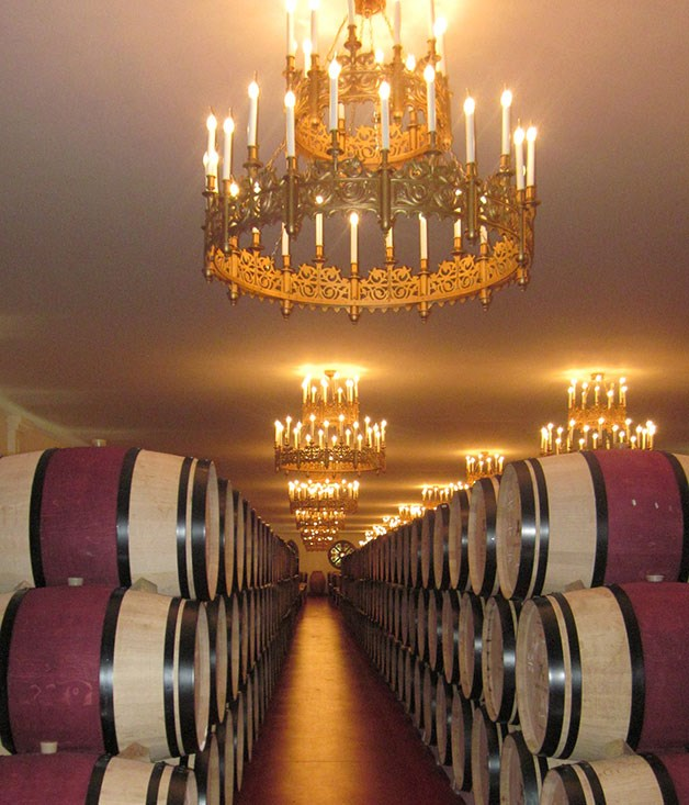 Wine barrels at Château Pape Clément.