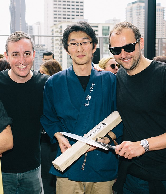 **Eleven Madison Park** Eleven Madison Park restaurateur Will Guidara, left, and chef Daniel Humm, right, recieve a commemorative knife from Suisin Knives' Tatsuya Aoki on behalf of Tanto, QT Melbourne's Japanese knife shop.