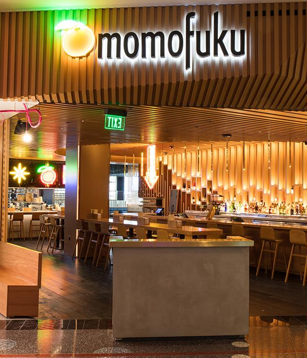**Tables in Vegas** Momofuku's new Las Vegas outpost isn't an exact analogue of its New York City cousins, whether it be the freewheeling Ssäm and Noodle Bar or the fine-diner Ko, though it shares some personality traits from those eateries. The 200-seat restaurant's lengthy menu reads like a David Chang greatest hits album, with everything from the comfort of a bowl of ginger and spring onion noodles to the gluttony of the legendary bo ssäm, a slow-cooked hunk of pork that can feed 10. Everything on the menu bursts with that umami-focused swagger that made Chang's name, and, in its own way, Momofuku fits right in with Vegas's brand of debauchery - where else might eating a dinner comprised entirely of fried chicken and caviar feel quite so appropriate? High-rollers can rent a raised private room (lined with custom peach-themed carpet, naturally) that looks out over the Strip, and the rest of us can slurp that famed porky ramen under a canine-themed David Choe mural. It's a new face of Vegas cool, and we're all in. [vegas.momofuku.com](https://vegas.momofuku.com/)