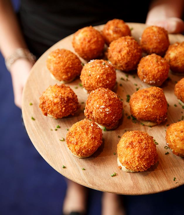 **Mushroom arancini** Guests nibbled on canapés including ocean trout tartare, goat's cheese tarts and mushroom arancini before the ceremony.  Photograph by Marcel Aucar.