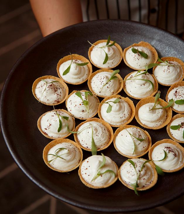 **Goat's cheese tarts** Guests nibbled on canapés including ocean trout tartare, goat's cheese tarts and mushroom arancini before the ceremony.  Photograph by Marcel Aucar.