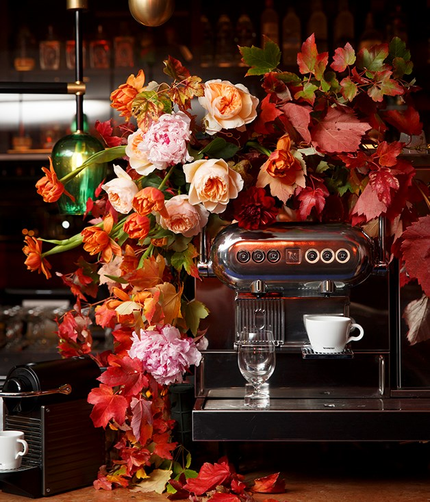 **Autumn colours** The room was filled with fresh flowers and foliage in autumnal hues, even decorating the vintage coffee machines from Nespresso.  Photograph by Marcel Aucar.