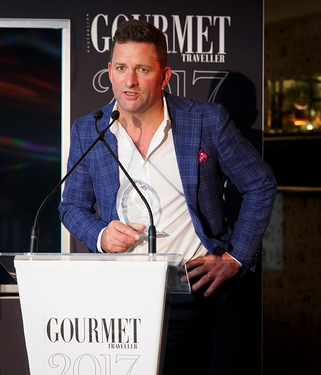 **QT Melbourne wins two awards** Troy Cuthbertson, general manager, QT Melbourne accepts the award for Large Hotel of the Year. The latest in QT's stable of hotels in Australia and New Zealand, QT Melbourne also won the award for Best Bar.  Photograph by Marcel Aucar.