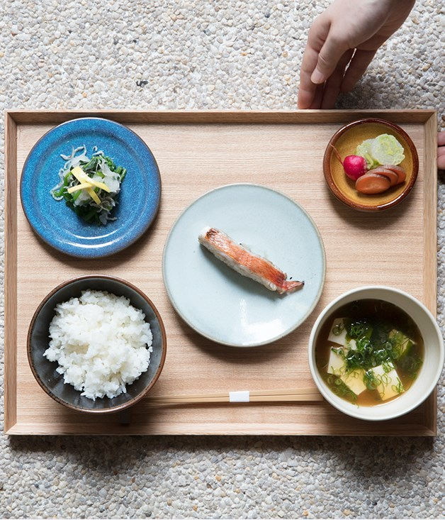 **Dishes served on a handmade tray** Sasaki's father spent six months carving 40 wooden trays made out of local black persimmon wood. Many have natural marks resembling calligraphy brushstrokes.   _Photo by: Brett Boardman_