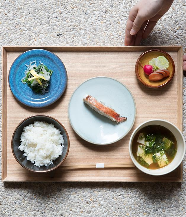 **Dishes served on a handmade tray** Sasaki's father spent six months carving 40 wooden trays made out of local black persimmon wood. Many have natural marks resembling calligraphy brushstrokes.  _Photo by:Brett Boardman_