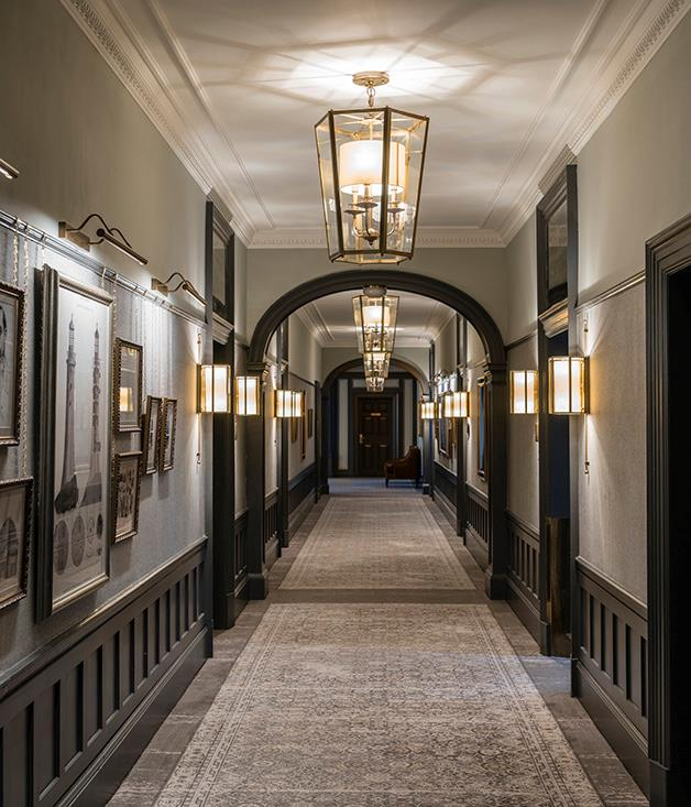 **Upper hallway** Custom lanterns and historical curious line the hallways of the estate.