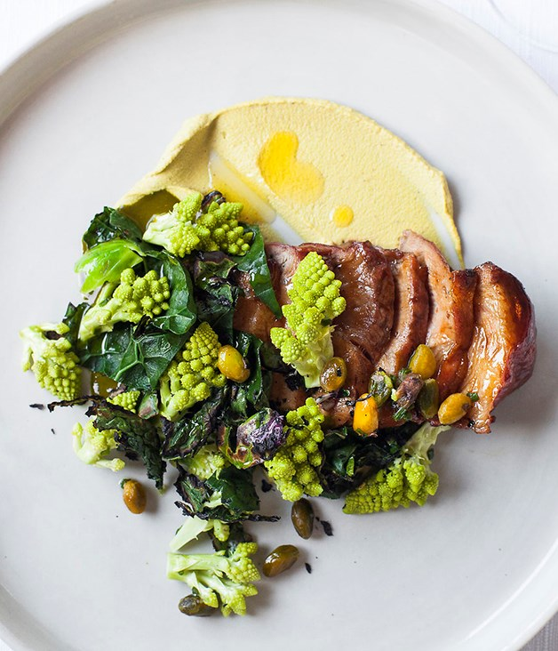 **Dry-aged pork loin** Served with romanesco, cavolo nero and pistachio.