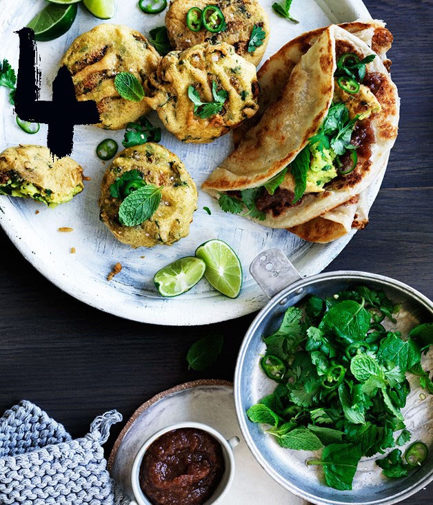 "[**Spiced potato and pea fritters with sweet and sour chutney**](https://www.gourmettraveller.com.au/recipes/browse-all/spiced-potato-and-pea-fritters-with-sweet-and-sour-chutney-12584|target=""_blank"") <br><br> Vada pav, popular roadside snacks in India, are potato fritters served burger-style in a white roll; we've wrapped ours in roti. Don't be shy with the condiments; add a dollop of thick natural yoghurt if you'd like to tone down the heat."
