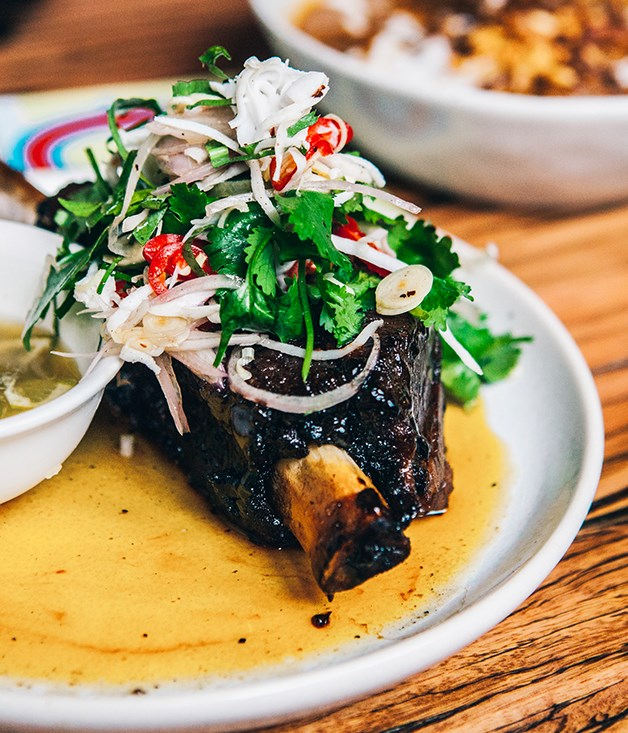 """**Twice-cooked beef short rib with shaved coconut salad and prik nahm pla** Although this was a signature dish of the original Chin Chin in Melbourne, Lucas says the kitchen will be taking full advantage of a charcoal pit and rotisserie to give the beef short rib and other classics a """"Sydney twist"""".  """"The rib is normally cooked for about eight hours before being glazed to finish it off. In Sydney, we're going to finish it off in the barbecue pit so it gets a beautiful crustiness and an added dimension of smokiness,"""" he says.  _Photo by Tom Ferguson._"""