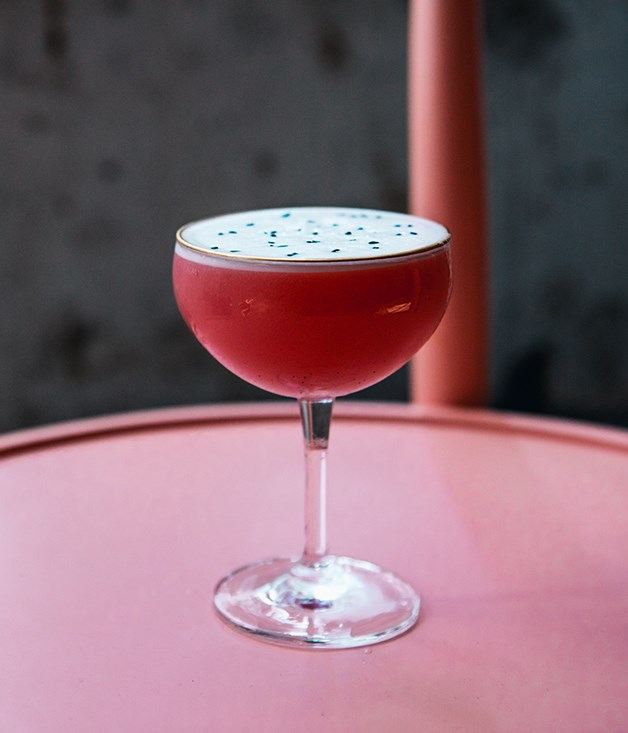 """**Dragonfruit cocktail** Four Pillars Bloody Shiraz gin headlines the tangy Dragonfruit - a mix of lemon, Angostura bitters, fresh dragon fruit and a sunflower kernel orgeat that's made to mimic the distinctive flesh of its namesake.  Chris Lucas recommends trying all the cocktails. """"Michael Chiem \[of PS40\], who's regarded as one of the top cocktail guys in Australia, has curated the cocktail list for us. He's come up with some very unique tropical Asian flavour profiles.""""  _Photo by The Lucas Group._"""