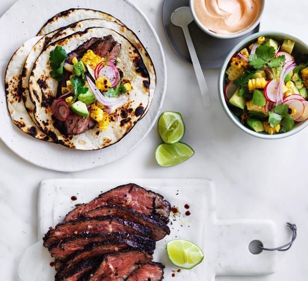 Flank steak tacos with corn, avocado and coriander