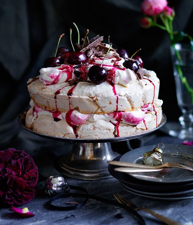 **Cherry Ripe pavlova** This layered pav channels the Cherry Ripe: coconut, sweet cherries and chocolate. It's beautifully delicate and will crumble and crack, but this is all part of its charm.