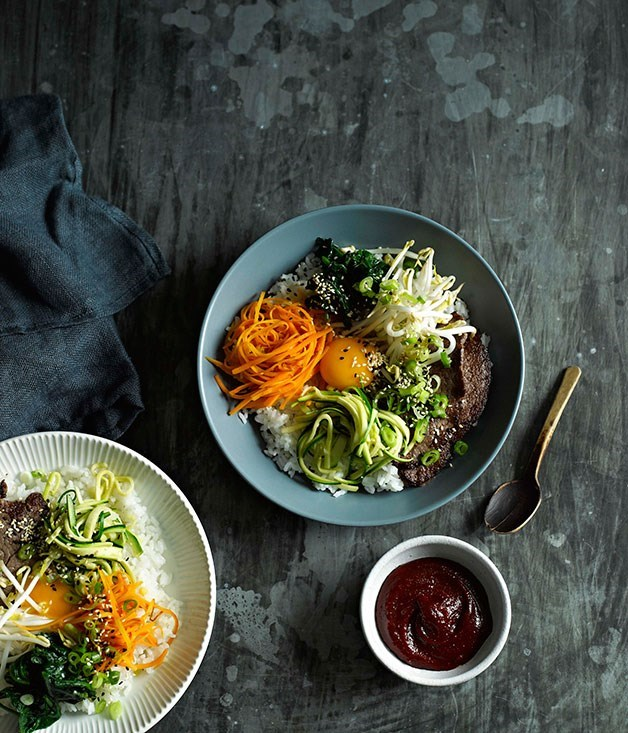 "[**Beef bibimbap**](https://www.gourmettraveller.com.au/recipes/fast-recipes/beef-bibimbap-13363|target=""_blank"") <br><br> The name of this Korean classic means ""mixed rice"". Vegetables, meat, sometimes seafood, and egg are served on bowls of rice and mixed together just before eating and seasoned with a chilli paste."