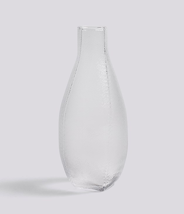 **Tela carafe** Tela is the Spanish word for textile and it's also the story behind the textured surface of this carafe. Each piece is created by blowing molten glass into a textile bag, creating a unique set of imprints. For the singular person in your life._[hay.dk/en](http://hay.dk/ms-my), $99_