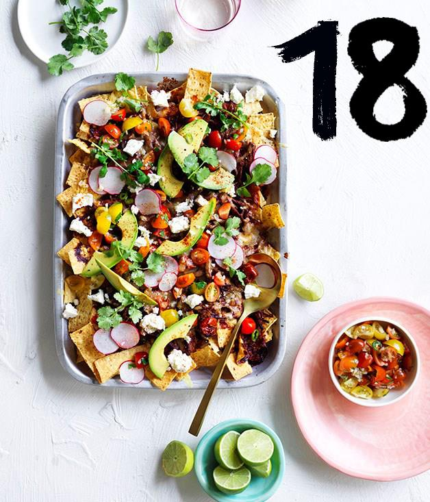 "**[Loaded beef brisket nachos](https://www.gourmettraveller.com.au/recipes/browse-all/loaded-beef-brisket-nachos-12926|target=""_blank"")** <br><br> Ever the crowd-pleaser, nachos make feeding the hordes simpler than ever, and each element of this loaded version - packing different flavours and textures - helps it make an impression. The beef takes time, yes, but if you set the oven just a little lower, you can leave it to cook overnight and wake to fork-tender brisket."