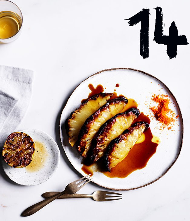 "**[Roasted pineapple with chilli salt](https://www.gourmettraveller.com.au/recipes/chefs-recipes/roasted-pineapple-with-chilli-salt-8636|target=""_blank"")** <br><br> ""The trick here is to turn and turn and turn the pineapple - like it's on a rôtisserie - until it's really caramelised and softened and all the juice comes out,"" says Mat Lindsay. ""It's sweet, sour, spicy, sticky and a little bit salty. A very simple recipe with complex flavours."""