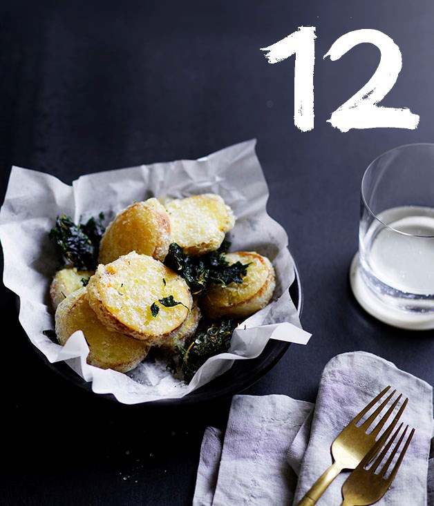 "**[Potato scallops](https://www.gourmettraveller.com.au/recipes/chefs-recipes/potato-scallops-8638|target=""_blank"")** <br><br> ""A classic Australian snack. Potato scallops (also known as potato cakes in many states) are usually made with beer batter, but we use a tapioca flour batter, which is gluten-free and helps them stay crisp, even when coated with sauce,"" says Mat Lindsay. ""These particular scallops taste just like salt and vinegar chips."""