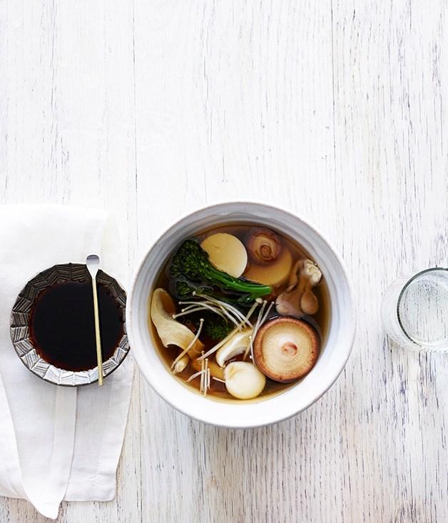 Silken tofu in a dashi broth with mushrooms and broccolini