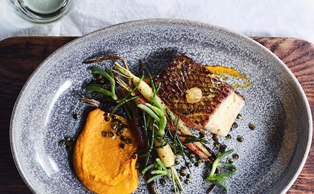 Pan-roasted toothfish with native succulents at Ayers Rock Resort's Mayu Wiru dining experience.