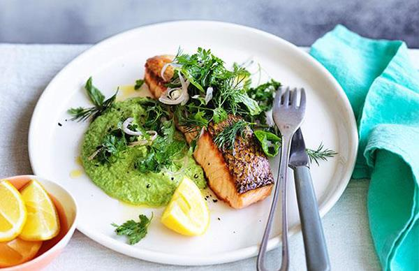 Crisp-skinned salmon with pea purée and soft-herb salad