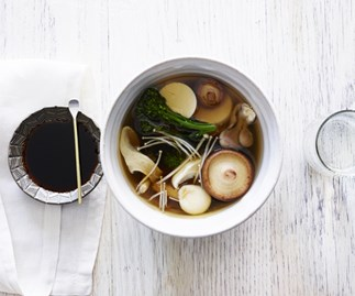 Silken tofu in a dashi broth with mushrooms and broccolini
