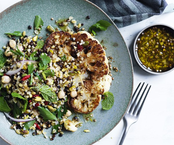 Cauliflower steaks with grain salad and spiced dressing